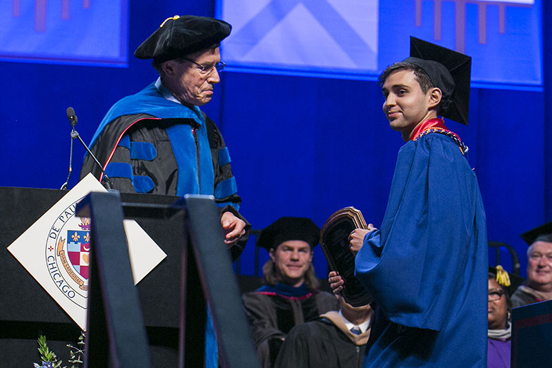 Omar Ortiz right, receives the Dean's Outstanding Senior Award.