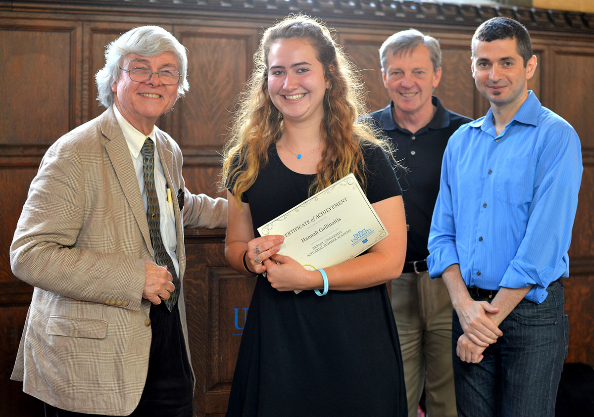 Hannah Gallinaitis from Hinsdale Central High School receives her graduation certificate from Actuarial Academy leaders