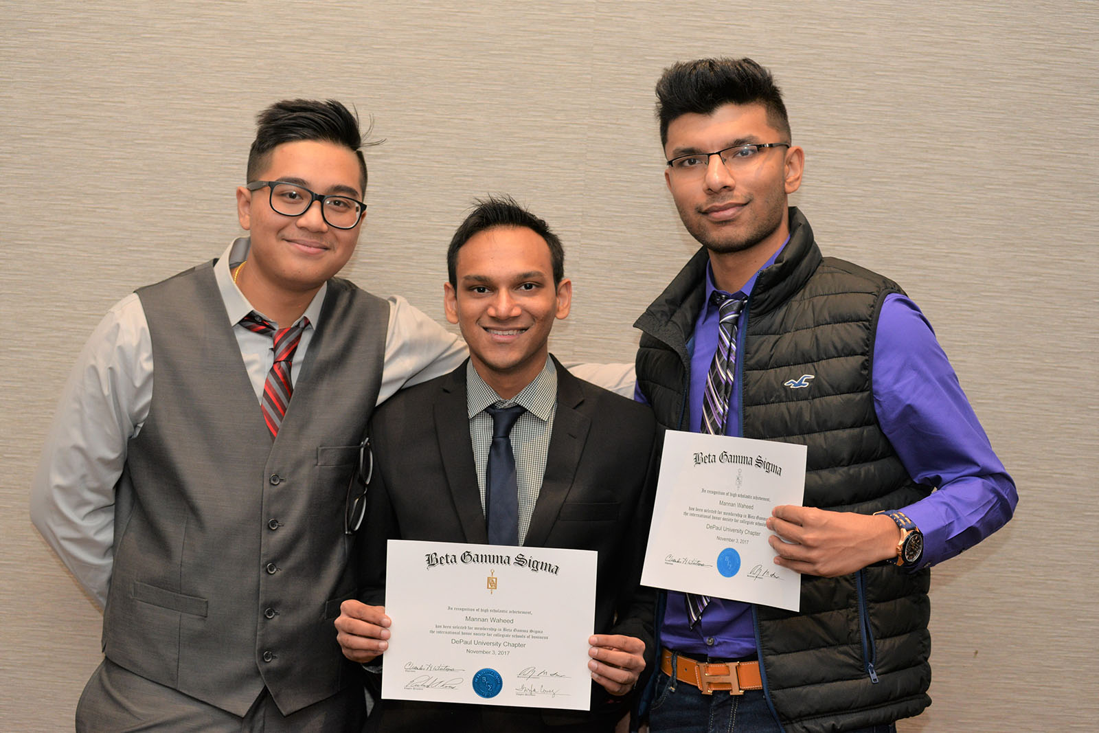 DePaul business students pose with their Beta Gamma Sigma induction certificates.