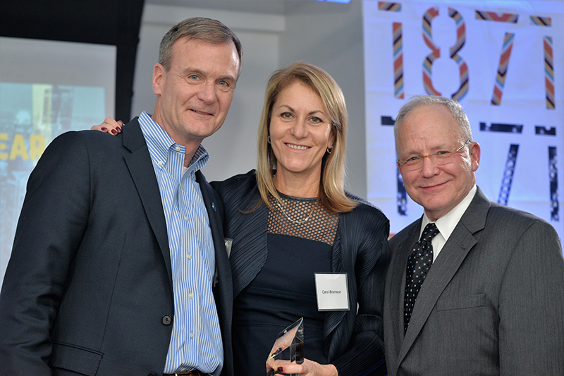 Carol Bramson (BUS '89), investor and CEO; founder, TBG Capital; won the Distinguished Entrepreneur of the Year award. From lef to right: Barmson; Bruce Leech, executive director of the Coleman Center; and Michael W. Hennessy, president and CEO of the Coleman Foundation.