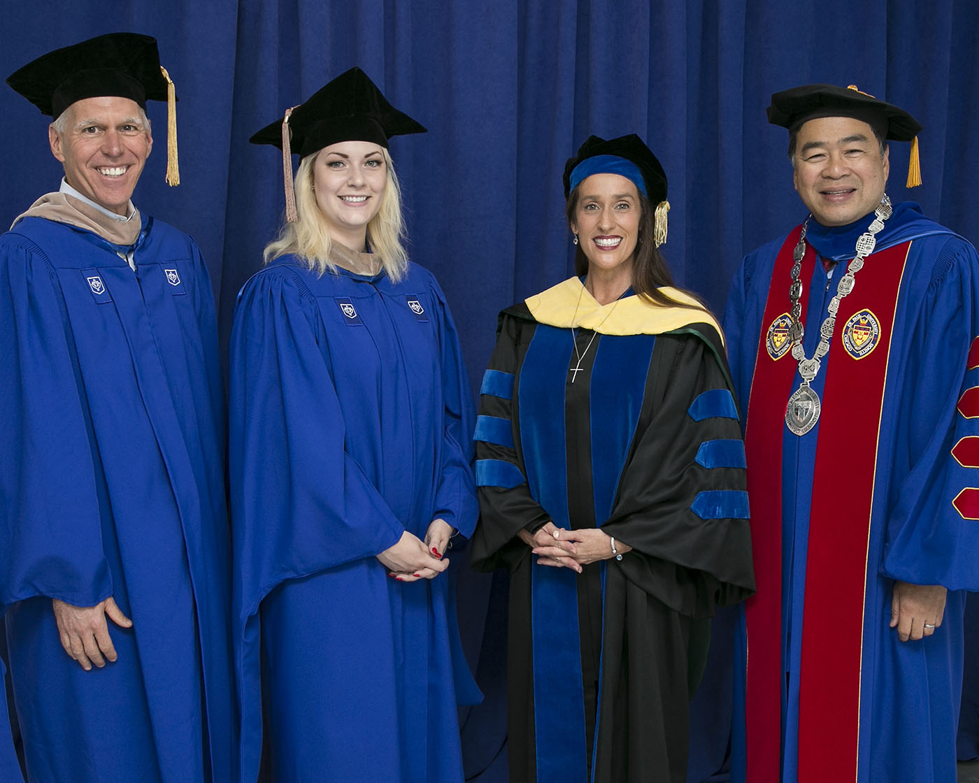 James T. Ryan III, chair of the board of trustees; Alyssa Poniatowski, Class of 2018 student speaker; Misty M. Johanson, dean of the Driehaus College of Business; and A. Gabriel Esteban, Ph.D., president of DePaul at the Wintrust Arena