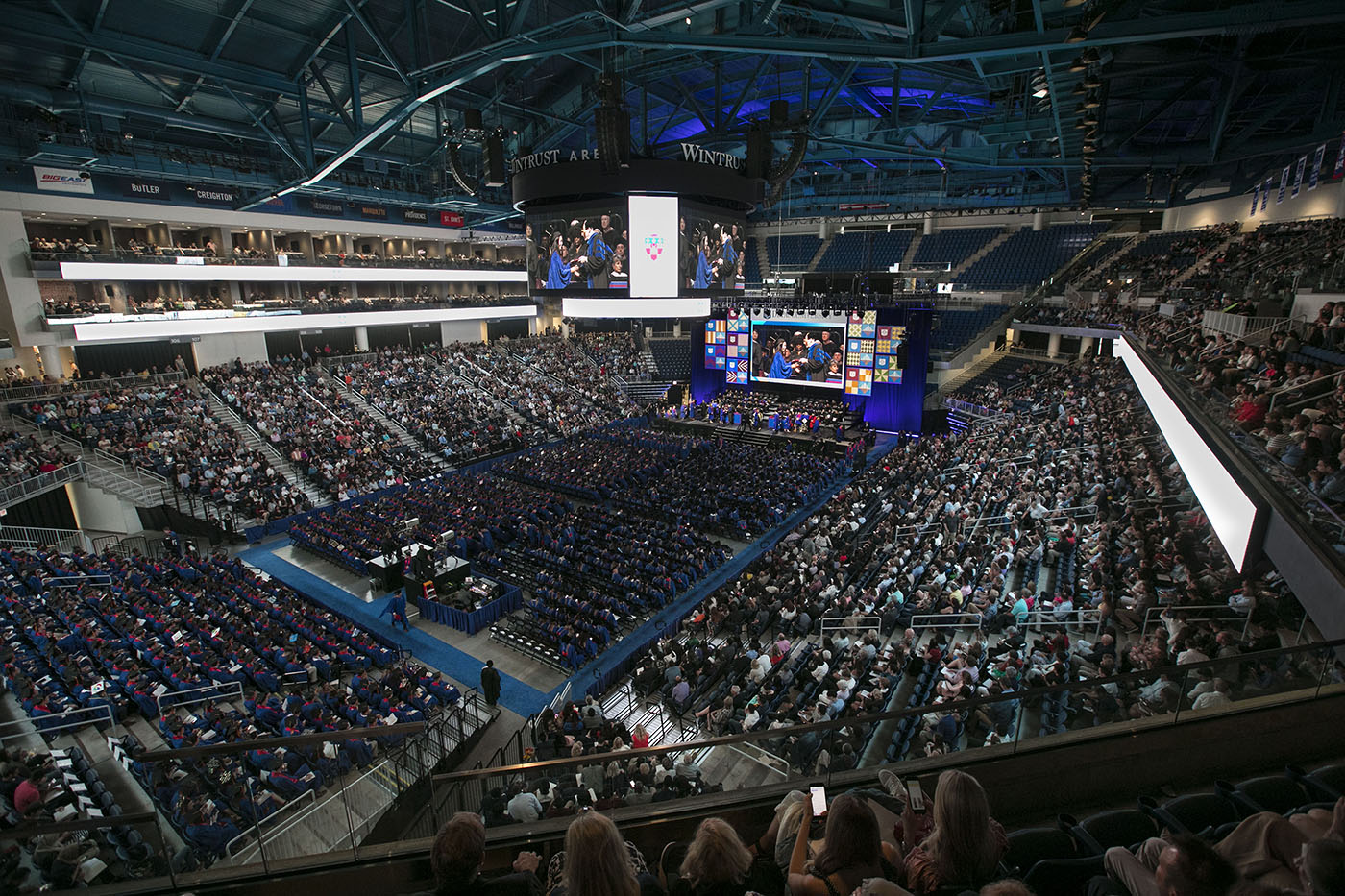 Friends and family join DePaul graduates inside Wintrust Arena, Sunday, June 10, 2018, for the Driehaus College of Business commencement ceremony