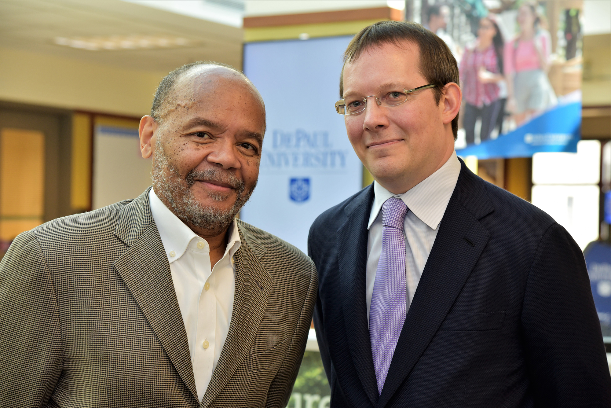 Elijah Brewer, chair of DePaul's Department of Finance, and Paul G. Savor, newly appointed Christopher L. Keeley Chair in Investment Management.