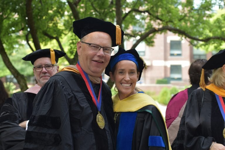 Tom Berry, finance professor and ​associate dean for faculty and student success, and Dean Johanson prepare to attend DePaul's 121st Academic Convocation to kick off the school year this fall.