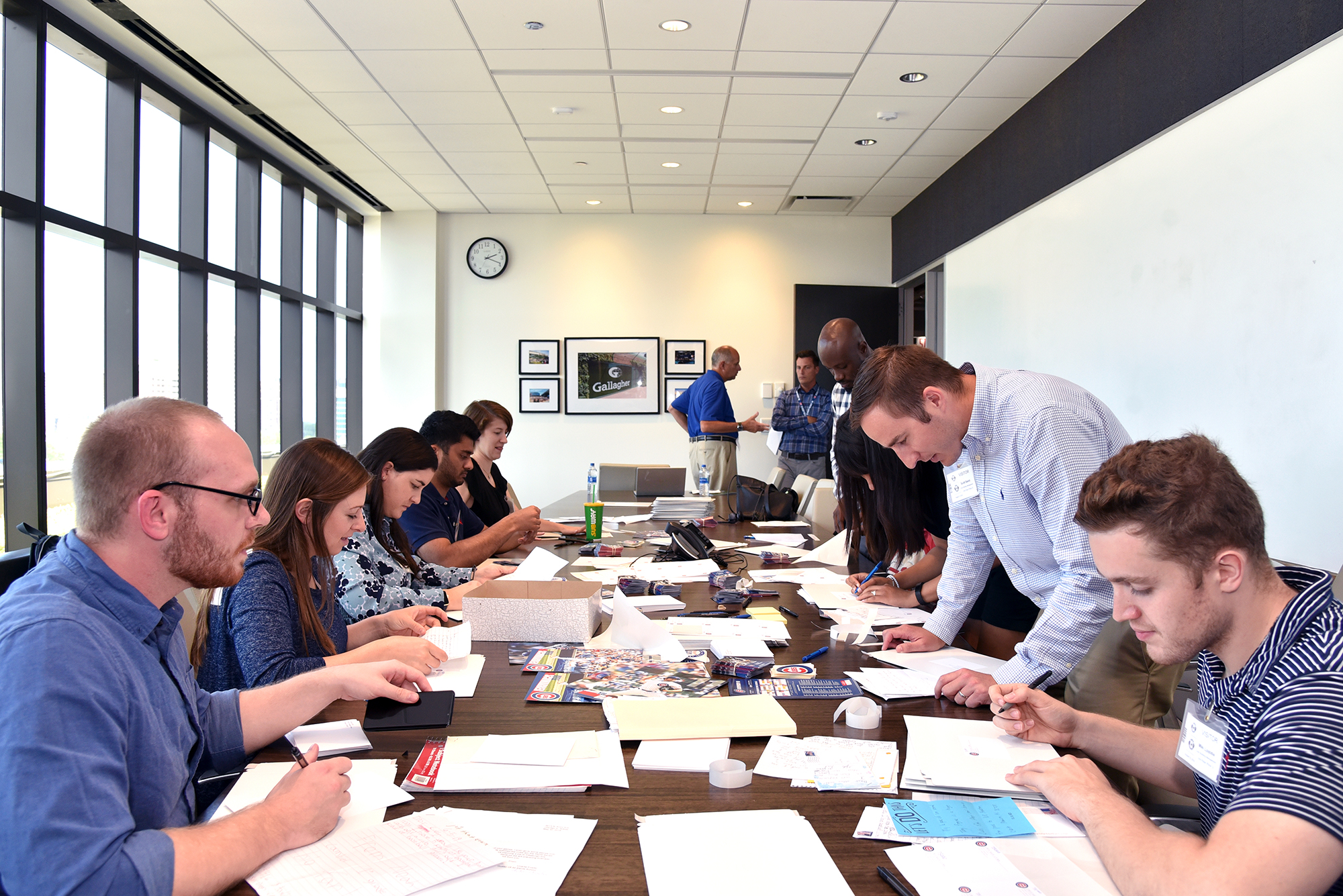 Students work in a conference room during the Cubs service class